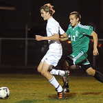 EC Gage Jarvis breaks away from Columbia 17 Nate Hite to score the first goal in Div.III district semi-final at Elyria Catholic on Oct. 23.  Steve Manheim