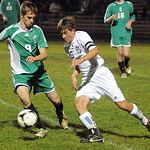 Columbia 9 Brendan Shields goes up against EC Michael Saddler in Div. III district semi-final Oct. 23.  Steve Manheim