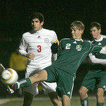 EC's Gage Jarvis takes a shot on goal; #3 for Hawken is Zack Whiting.