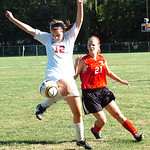 Elyria's #12 Michelle Mariner keeps the ball from Brookside's #21 Christina Kebeiks.