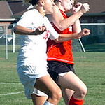 Elyria's #16 Abbey Ramirez and Brookside's #4 Sara Porter go up for the header.