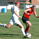 Elyria's #17 Natalie Benko kicks the ball past Brookside's #18 Alexis White.