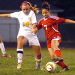 North Ridgeville's No. 10 Kaleigh Asp fights Elyria's No. 7 Celeste Jones for the ball.