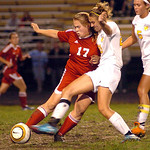 Elyria's No. 17 Natalie Benko fights North Ridgeville's No. 21 Emily Lesniak for the ball.