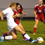 North Ridgeville's No. 21 Emily Lesniak fights Elyria's No. 1 Heather Robinson for the ball.