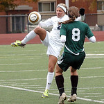 Magnificat's Sarah Lawrence clears the ball from Westlake's Lauren Hurst. LINDA MURPHY/CHRONICLE