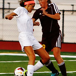 Avon's Alli Clark and Avon Lake's Olivia Siko go head-to-head. AMANDA K. RUNDLE/CHRONICLE