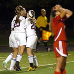Avon Lake players celebrate and an Elyria player reacts in frustration Monday following a Shoregals goal in a Division I sectional opener at Avon Lake High School. The Shoregals won, 2-0. LI …