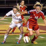 Avon Lake's Mae Quinn, left, and Elyria's Abbey Ramirez fight for the ball. LINDA MURPHY/CHRONICLE