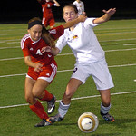Elyria's Darian Jones, left, and Avon Lake's Clare Adams fight for the ball. LINDA MURPHY/CHRONICLE