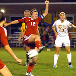 Elyria's Michelle Mariner tries to control the ball as Olmsted Falls' Rachel Caraffi watches. LINDA MURPHY/CHRONICLE