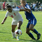 Midview's Morgan Hamker battles Elyria's Mickayla Gordon for the ball. KRISTIN BAUER | CHRONICLE