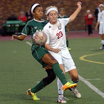 An Amherst player fights Megan Coyne for the ball. Linda Murphy/Chronicle