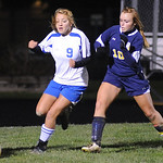 Midview's 9 Samantha Bauer and North Ridgeville Kaleigh Asp go for ball Oct. 18.  Steve Manheim