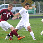 EC 36 Patrick Orsagos pushes away from Rocky River 6 Trent Newby Sep. 25.  Steve Manheim