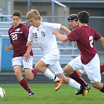 EC 28 Liam O'Halloran moves between Rocky River 20 Brett Scherzer and 2 Liam Duncan on Sep. 25.  Steve Manheim