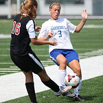 Brookside's Vanessa Vanzant (16) is blocked by Midview's Sidney Riemer (3) at Midview HS. photo by Ray Riedel