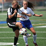 Brookside's Vanessa Vanzant takes control of the ball as Midview's freshman Maddie Blaine defends at Midview HS. photo by Ray Riedel