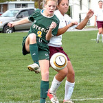 Amherst's #2 Lindsay Sands clears the ball from Wellington's #11 Elizabeth Bowman.