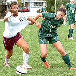 Wellington's #11 Elizabeth Bowman fights Amherst's #7 Amber Slavik for the ball.