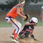 J. Head (#25) of M.C. Madness Black slides safe at second base as the Swarm's 2nd baseman R. Lovett looks to throw to first in the ASA state softball semi-final game. photo by Ray Riedel