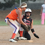 J. Head (#25) of M.C. Madness Black is safe at second base as the Swarm's 2nd baseman R. Lovett is a fraction of a second too late with the tage in the ASA state softball semi-final game. ph …