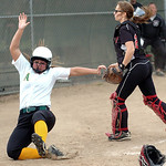 Amherst's runner #11 Katelyn Pittman slides safely home as Perkins' catcher #21 Shannon Matso goes for the ball.