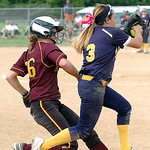 North Ridgeville's #3 Mamissa Garaballo reachs third base before Avon Lake's #16 Annie Wennerberg, who was called out.