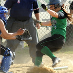 Columbia's Nicolette Kunath scores before the ball reaches Clearview's Angelica Flecha in fifth inning May 8.  Steve Manheim