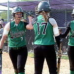 Columbia's #7 Nicolette Kunath and #10 Crystal Fetchet get high fives from #17 Christine Lyzen as they cross home plate. (CT photo by Linda Murphy.)
