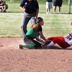 Junior shortstop Emily Viccaron applies the tag to complete the inning ending  StrikeOut/ThrowOut double-play.