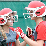 Elyria's Carly Bachna, right, celebrates with Anna Daly after scoring from third base on an illegal pitch in the eighth inning against Clay. DAVID RICHARD / CHRONICLE