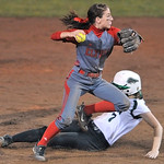 Elyria's Marie Masters looks to first base after forcing out Mason pinch runner Hannah Mizener on a fielder's choice in the sixth inning. DAVID RICHARD / CHRONICLE