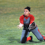 Elyria center fielder Kaitlyn Laseke makes a diving catch in the third inning against Mason. DAVID RICHARD / CHRONICLE