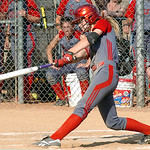 Elyria's #5 Carly Bachna hits a home run.