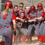 Elyria gets ready to greet #5 Carly Bachna after she hit a home run.