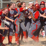 Elyria teammates greet #4 Alexis Roseboro as she crosses home plate following #5's home run.