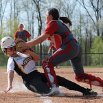 Elyria catcher Haley Looney tags out Medina's Lauren Peak at home plate in the bottom of the 4th inning.