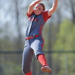 Elyria's Caitlyn Minney pitches in the bottom 3rd inning against Medina.