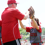 ANNA NORRIS/CHRONICLE Elyria's Mackanzie Phares high-fives assistant coach John Wallace in the fifth inning against Brecksville in the regional championship game Saturday at Clyde High Schoo …