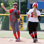 ANNA NORRIS/CHRONICLE Elyria short stop Carly Bachna throws to turn two outs against Brecksville in the fifth inning of the Division I Regional 2 championship game at Clyde High School Satur …