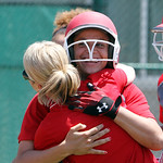 ANNA NORRIS/CHRONICLE Elyria's Kaitlyn Laseke smiles as she hugs assistant coach (need name) after hitting her second home run  in the Division I regional championship game against Brecksvil …