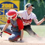 ANNA NORRIS/CHRONICLE Elyria's Alex Dick slides into second before Brecksville's Alexis Mack can make the tag in the fourth inning of the Division I Regional 2 championship game at Clyde Hig …