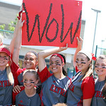 "ANNA NORRIS/CHRONICLE The Elyria Lady Pioneers softball team pose for pictures with a ""wow"" sign made by fans after their 4-0 regional championship win over Brecksville."