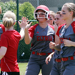 ANNA NORRIS/CHRONICLE Elyria's Kaitlyn Laseke high fives Elyria coach (need name) after hitting an out-of-the-park home run in the second inning against Brecksville in the Division I Regiona …