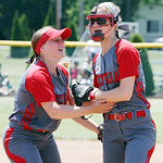 ANNA NORRIS/CHRONICLE Elyria's Elizabeth Ellis, left, celebrates with short stop Carly Bachna after Bachna threw out the base runner at first to close out the top of the sixth inning against …