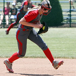 ANNA NORRIS/CHRONICLE Elyria short stop Carly Bachna scoops up the ground ball against Brecksville in the sixth inning in the regional championship game at Clyde High School Saturday afterno …