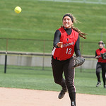 Firelands' Alexis Willis throws the ball to first in attempt to get the out in the second inning against Revere yesterday at Firestone Stadium in Akron. ANNA NORRIS/CHRONICLE