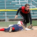 Firelands third base Cassidi Kowalski looks to the umpire for the call if Revere's Anna Warren is safe or out in the first inning yesterday at Firestone Stadium in Akron. ANNA NORRIS/CHRONIC …