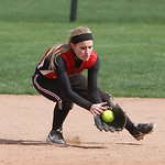 Firelands' Brittany Reising stops the ground ball against Revere in the bottom of the third inning yesterday at Firestone Stadium in Akron. ANNA NORRIS/CHRONICLE